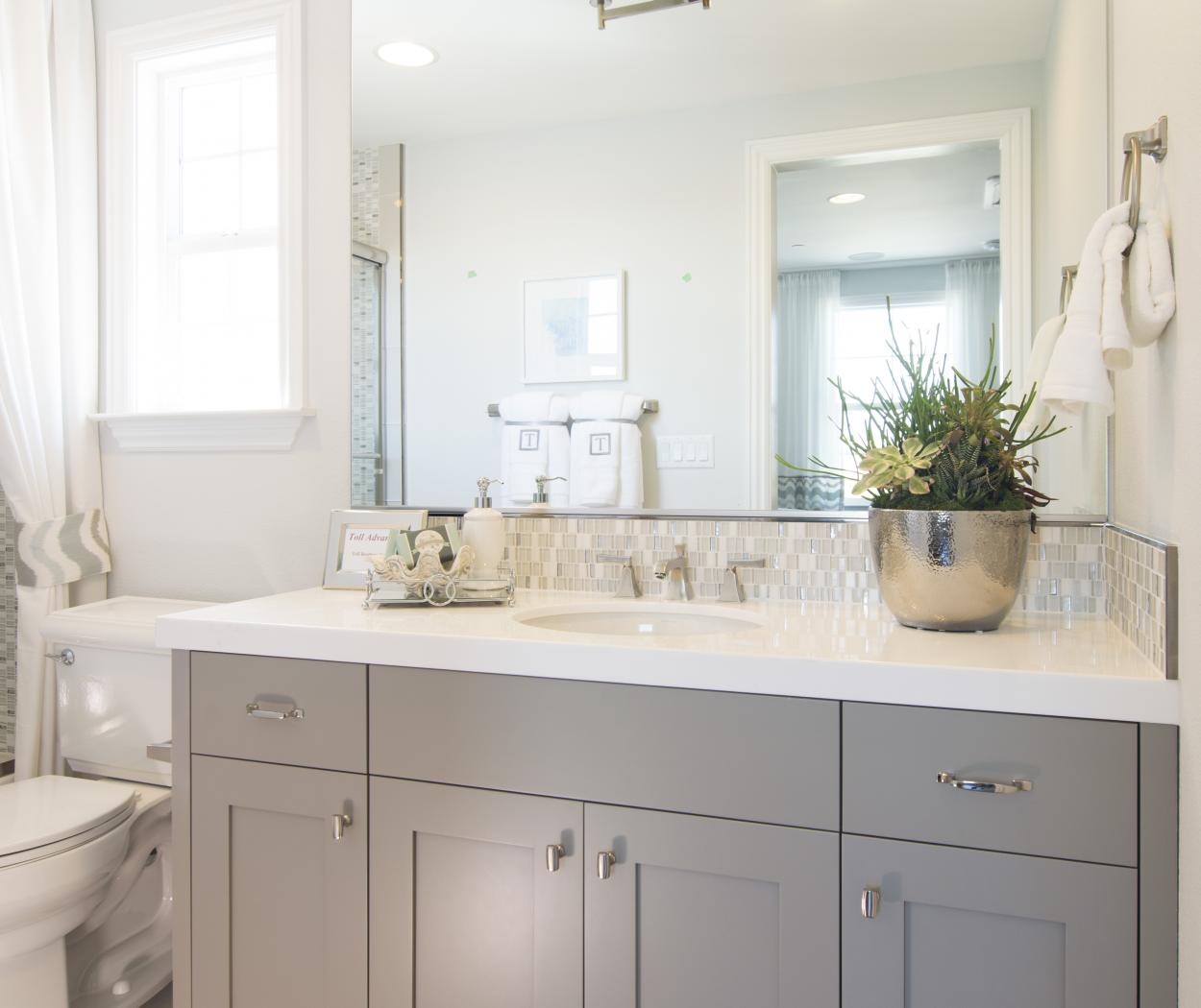 Transitional Painted Bathroom Vanity with a Beautiful White Counter Top and Silver Knobs - Pulls