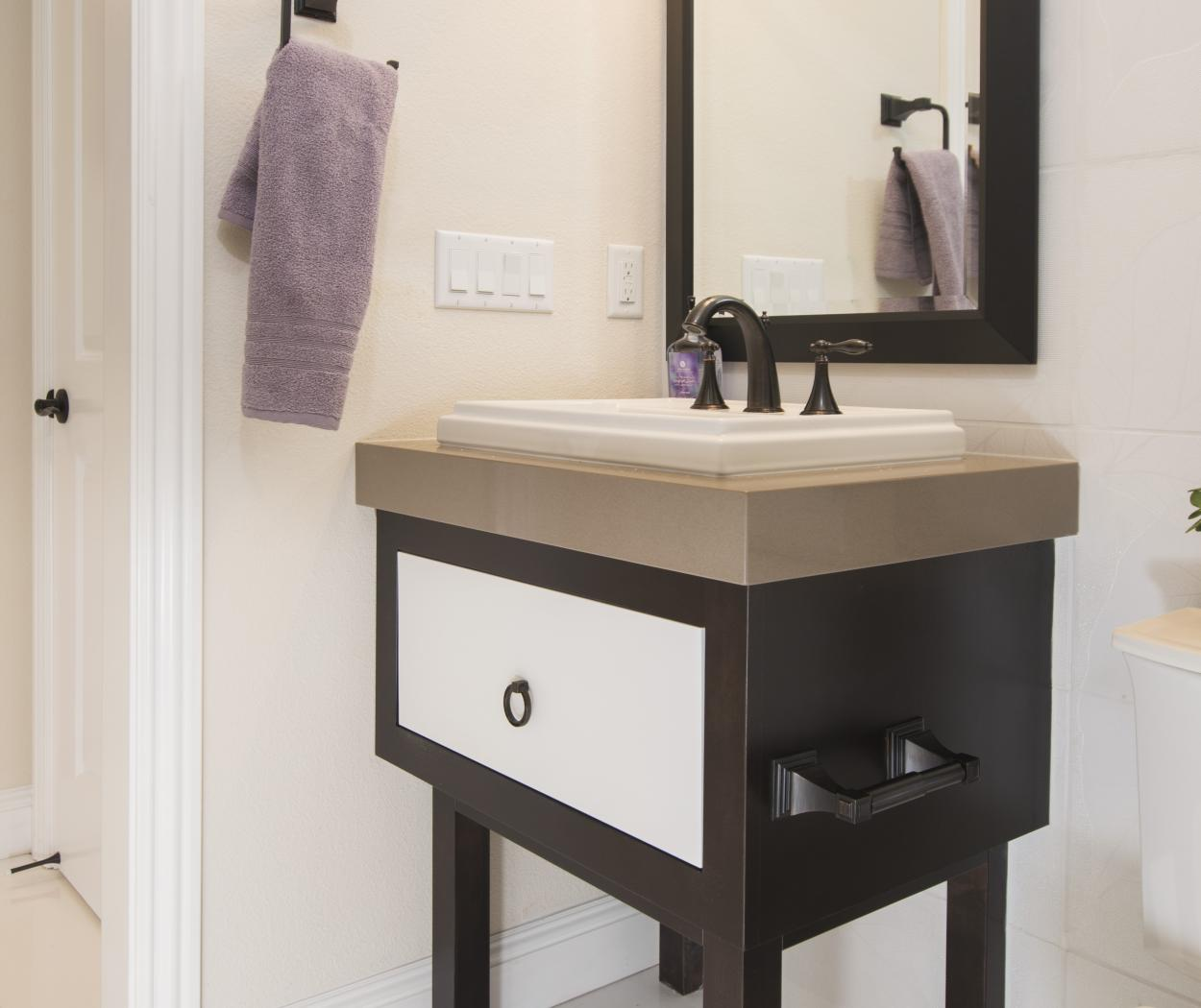 Contemporary Two Toned Bathroom Vanity with a Tan Counter Top and an Oil Rubbed Bronze Faucet