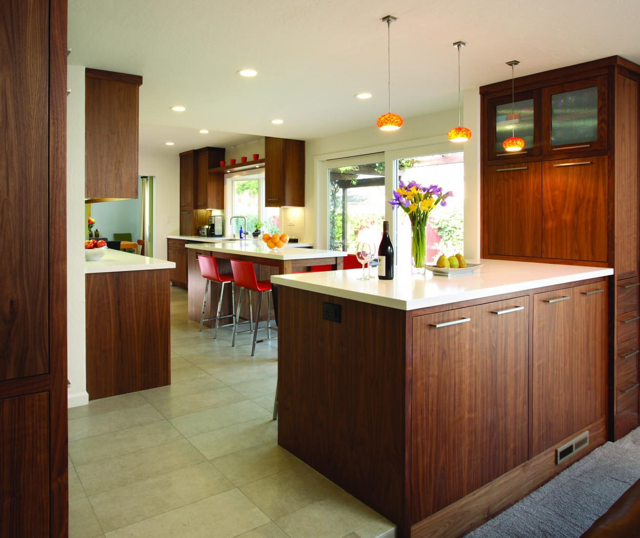 Contemporary Kitchen Built in Walnut with a Beautiful Natural Finish, White Countertops and Chrome Hardware