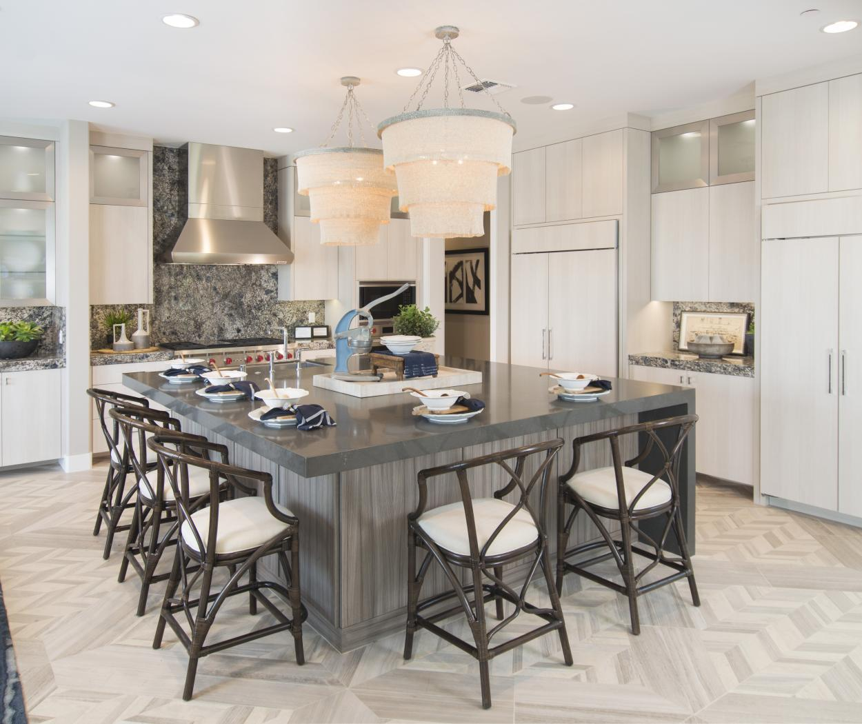 Contemporary White Kitchen with a Grey - Blue Island Built-in Textured Metro Material with Aluminum Door Frames, Glass Inserts and Stainless Steel Appliances