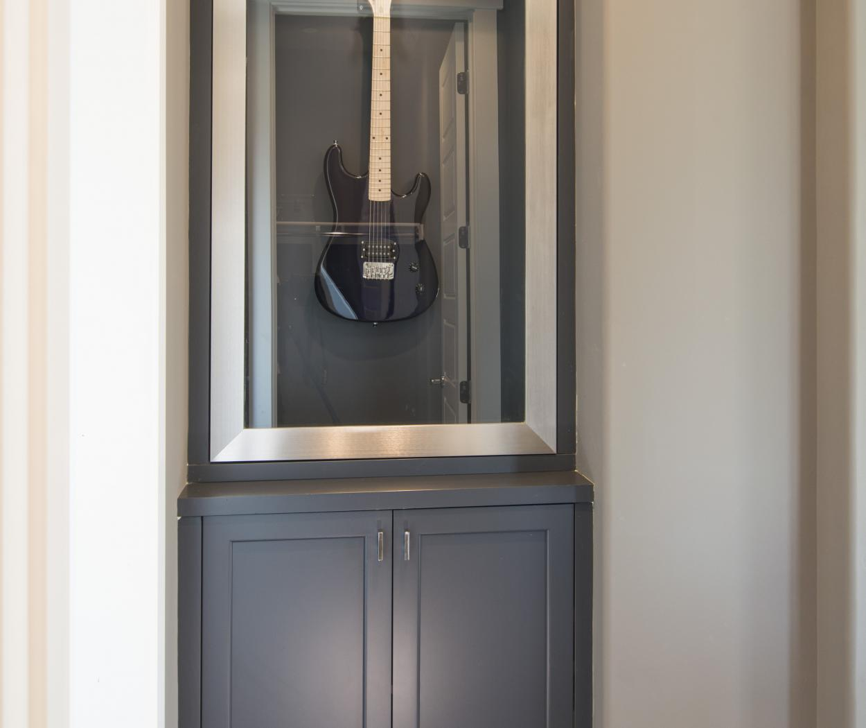 Gorgeous Hallway Built-In Painted in a Dark Grey - Blue with an Aluminum Door Frame and Glass Door