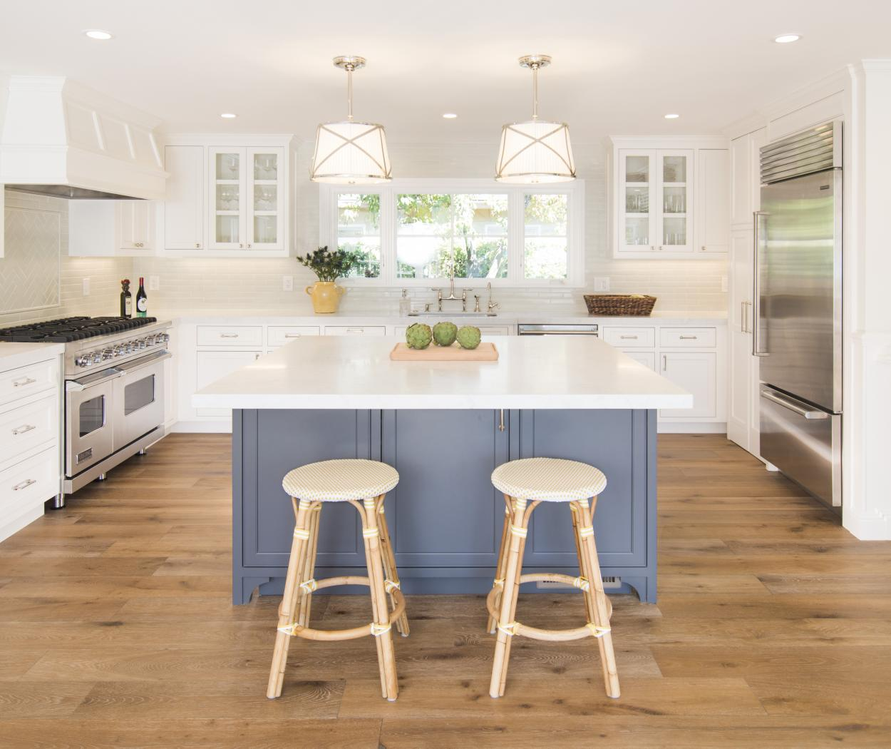 Transitional Two Toned Painted White Kitchen with a Blue Island, Glass Doors and Stainless Steel Appliances