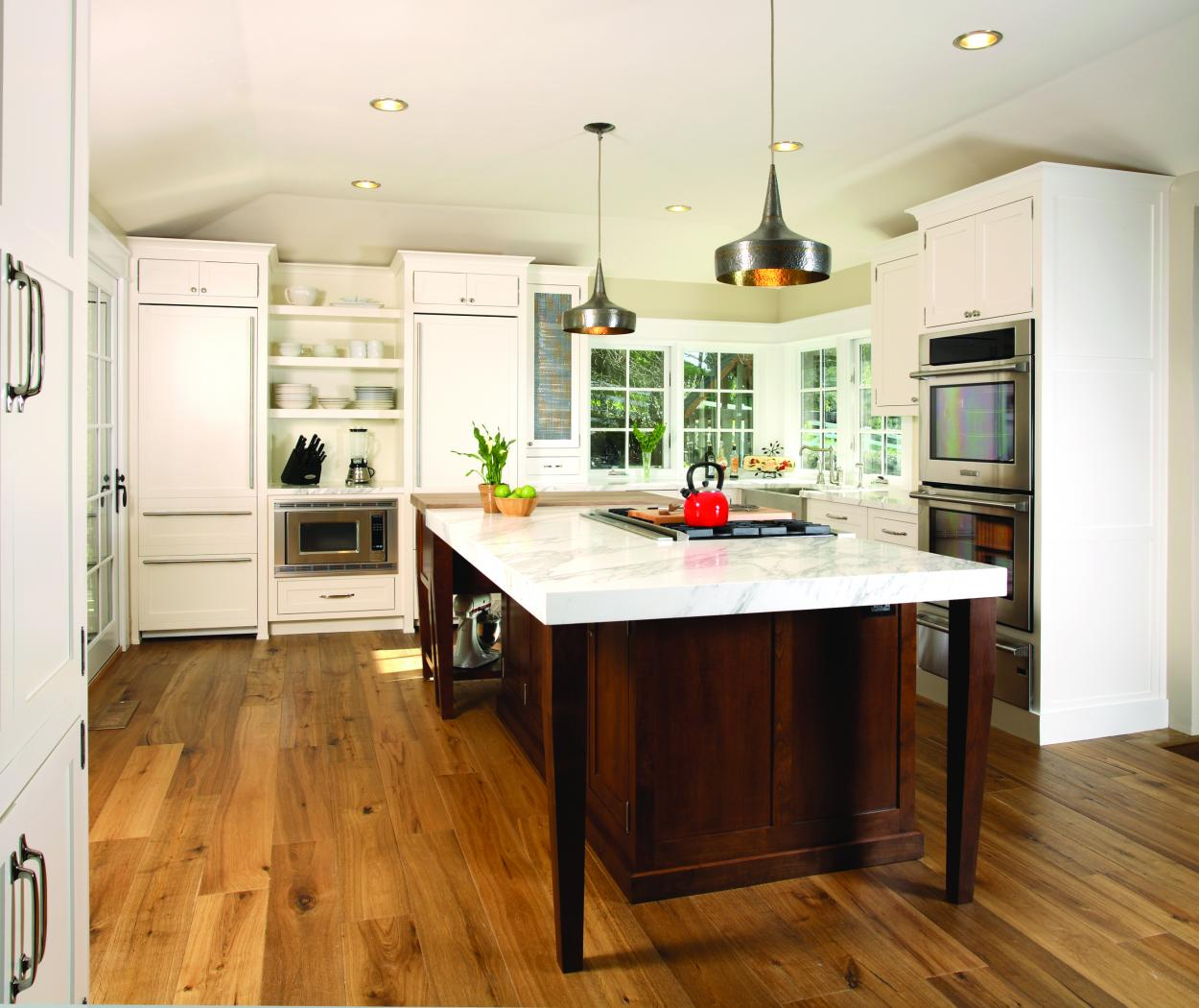 Transitional White Kitchen with a Chocolate Stained Island, Marble Countertops, Open Shelves and Stainless Steel Appliances