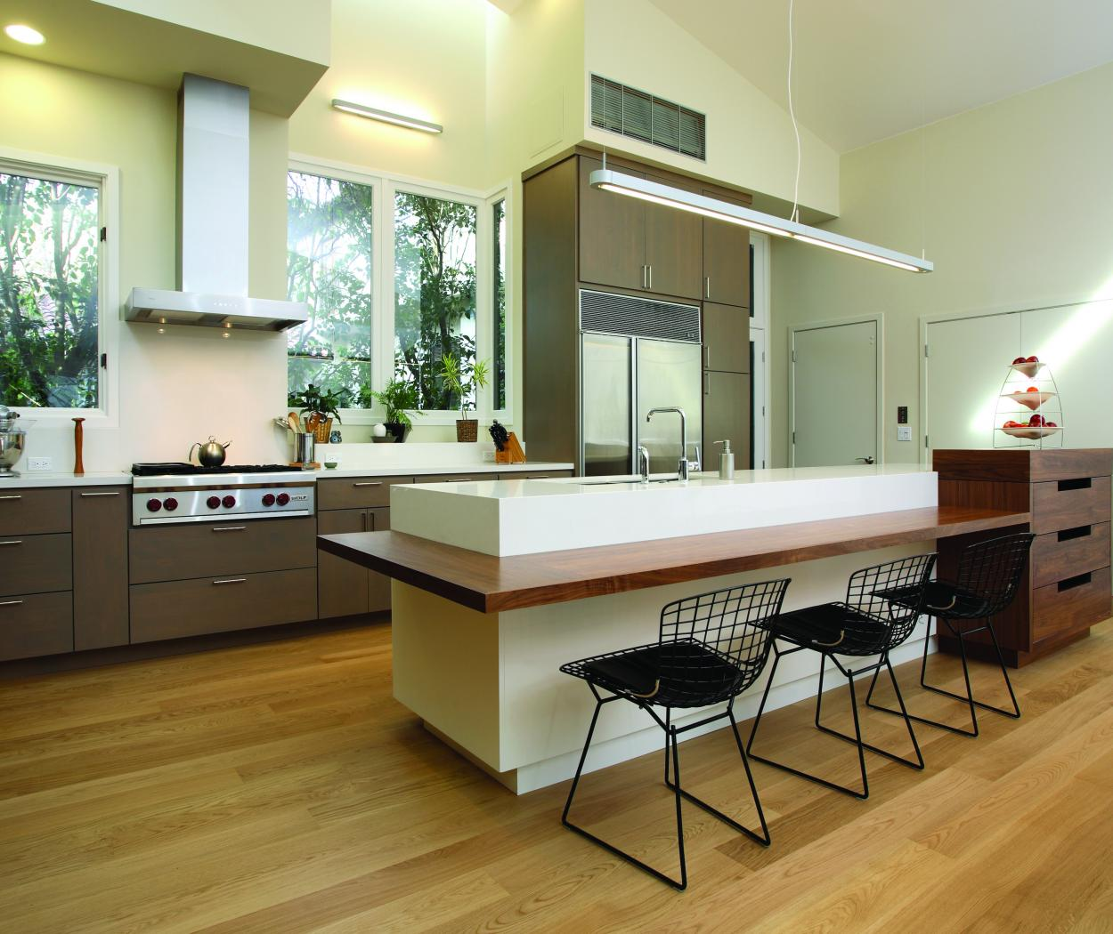 Contemporary Stained Kitchen with a White Island, Walnut Built-In Desk and Stainless Steel Appliances