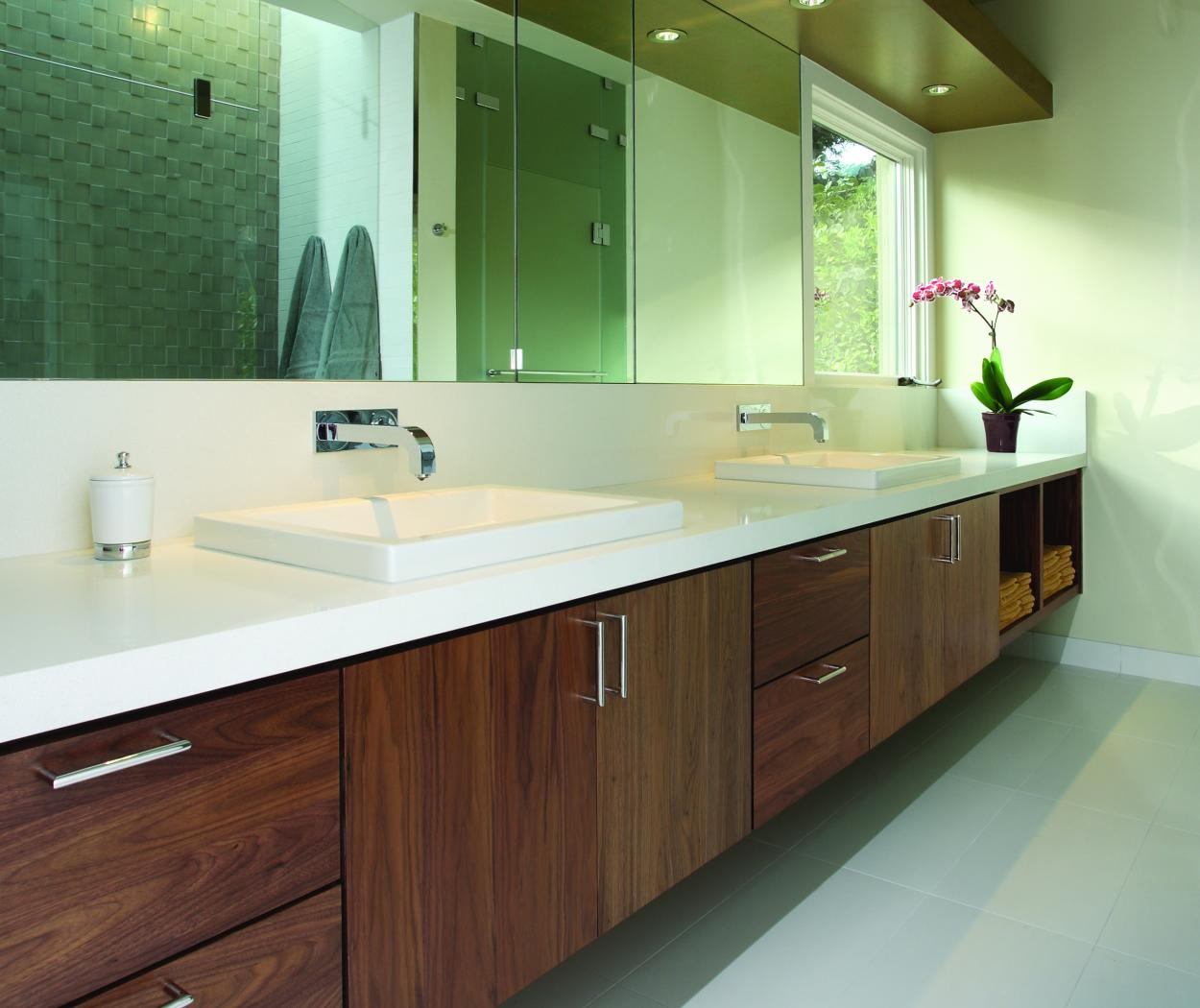 Contemporary Master Bathroom Vanity built in Walnut with a Beautiful Clear Finish, Double Sinks and a White Countertop
