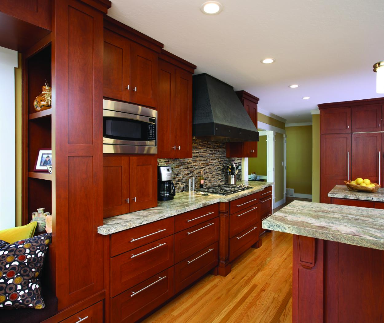 Transitional Stained, Shaker Style Kitchen with a Built-In Bench Seat, Beautiful Granite Countertops and Stainless Steel Appliances