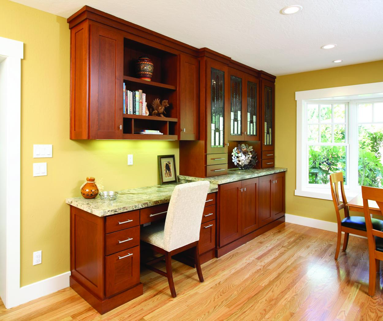 Transitional Stained Built-In Desk with Decorative Glass Doors, Open Shelves and a Beautiful Granite Countertop