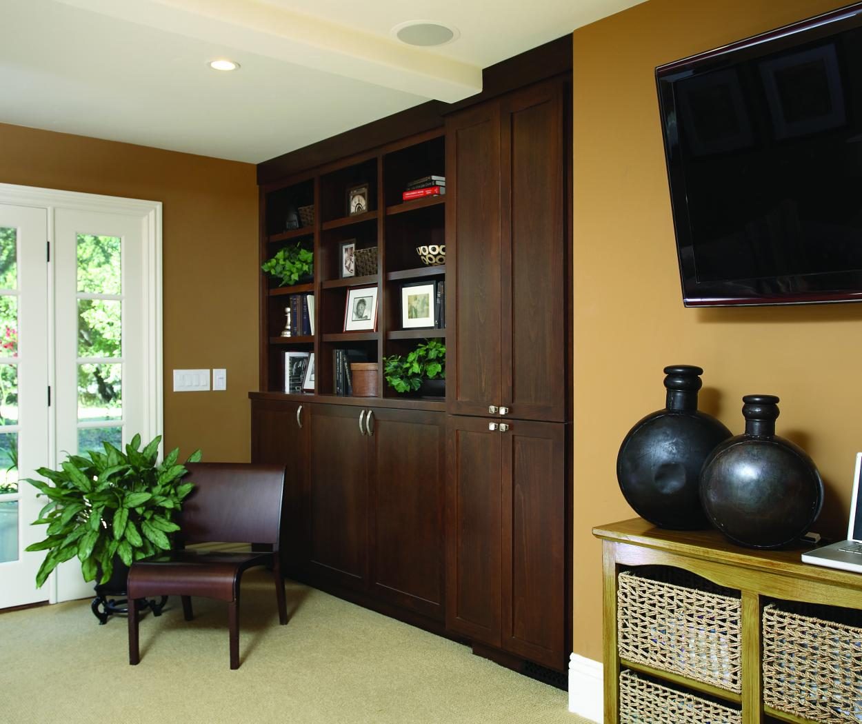 Traditional Chocolate Stained Family Room Built-In with Open Shelves and Chrome Hardware