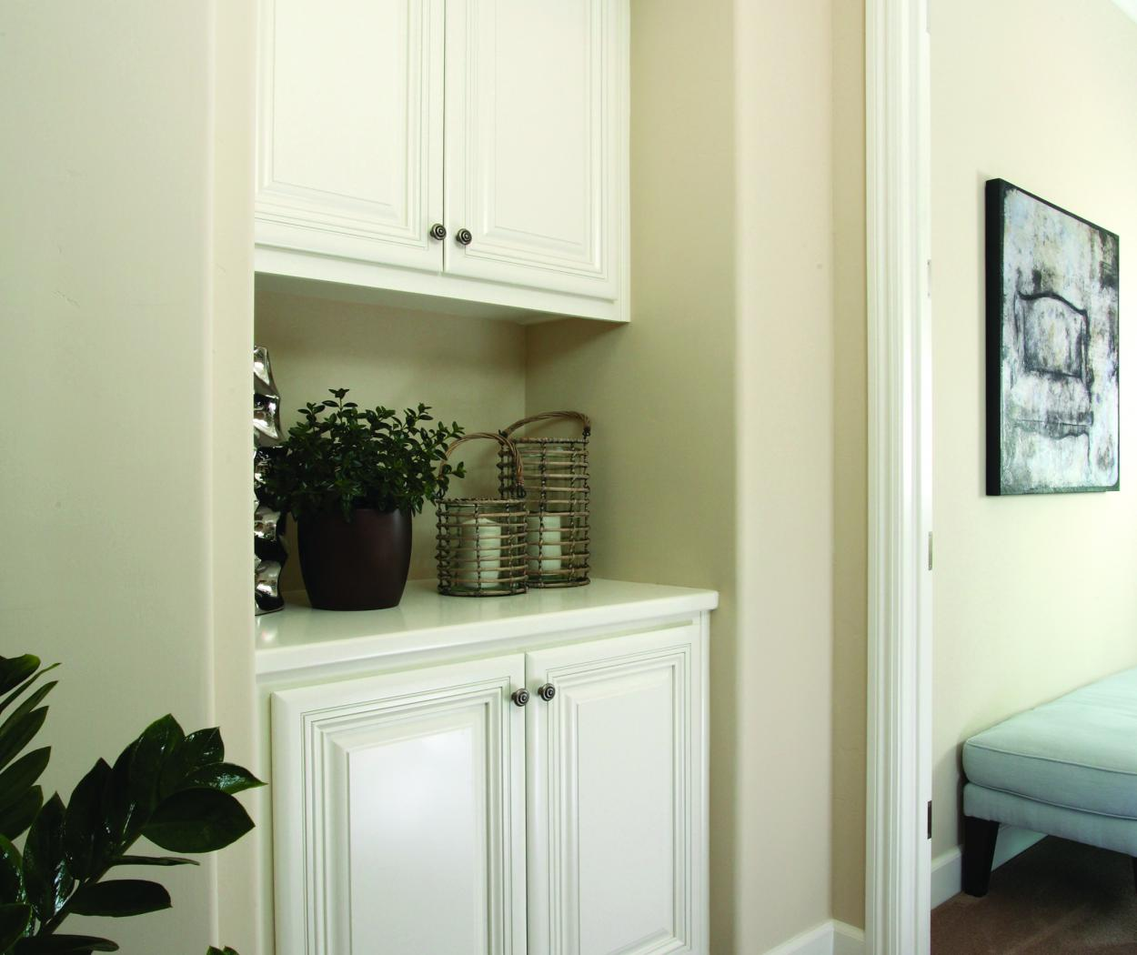 Traditional White Bedroom Built-In with Decorative Knobs