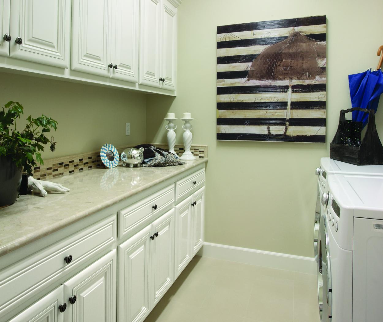 White Traditional Bathroom with a Beige Countertop, Decorative Knobs and a White Washer - Dryer