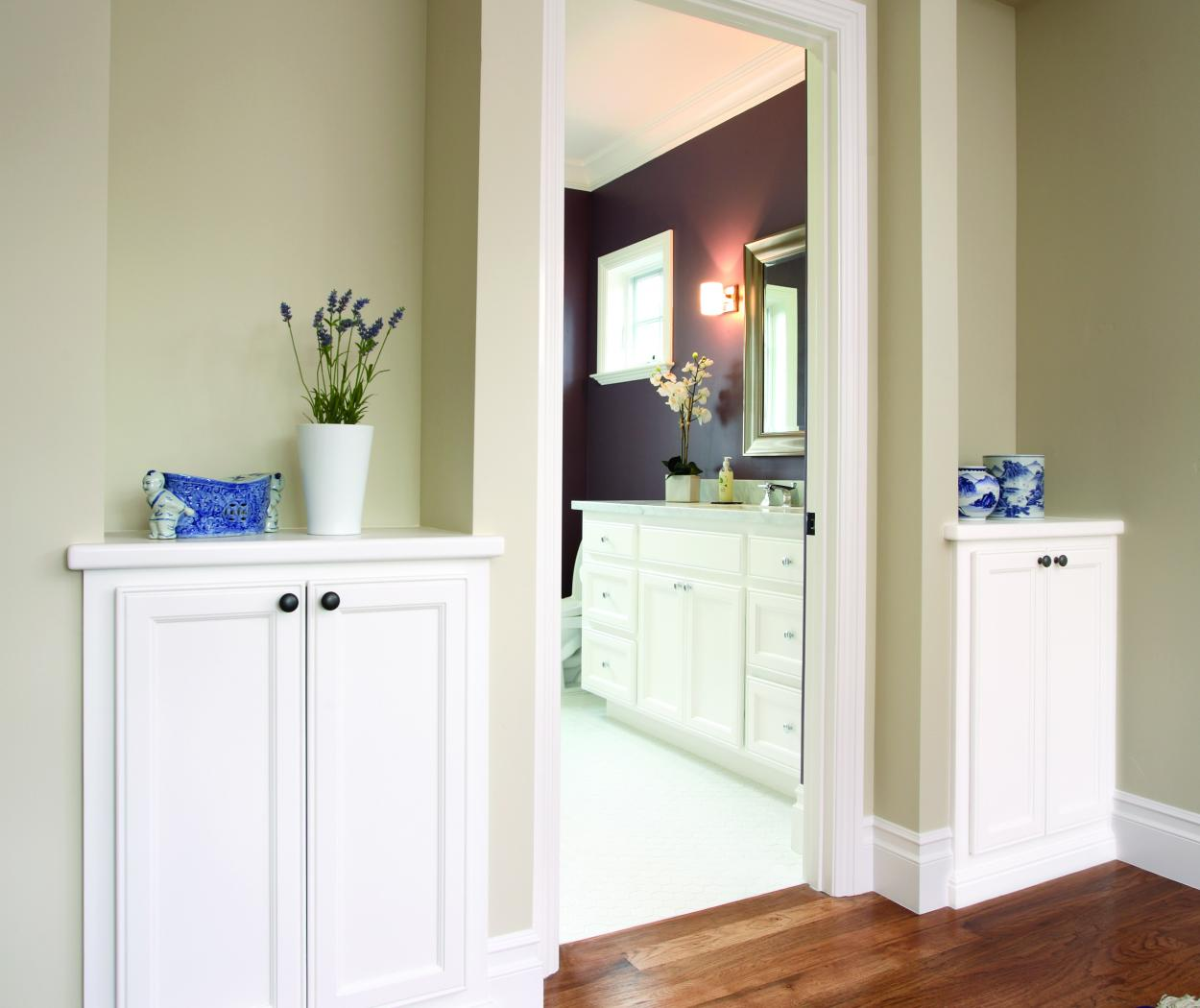 Two Transitional White Built-In Cabinets with White Counter Tops and Oil Rubbed Bronze Knobs