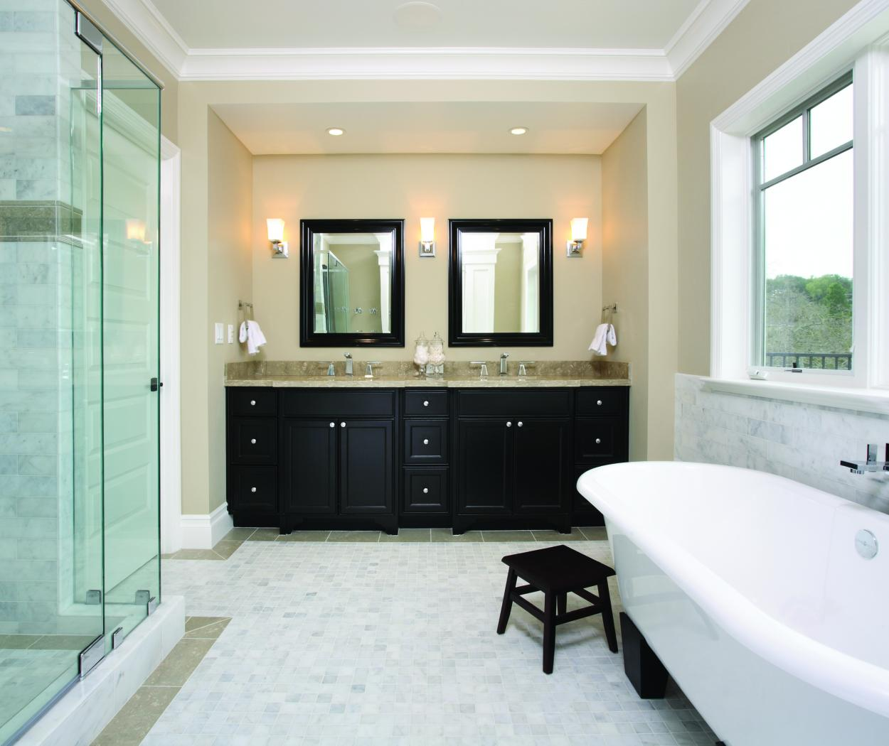 Transitional Master Bathroom Stained in Dark Espresso with a Beautiful Marble Counter Top and Polished Chrome Hardware