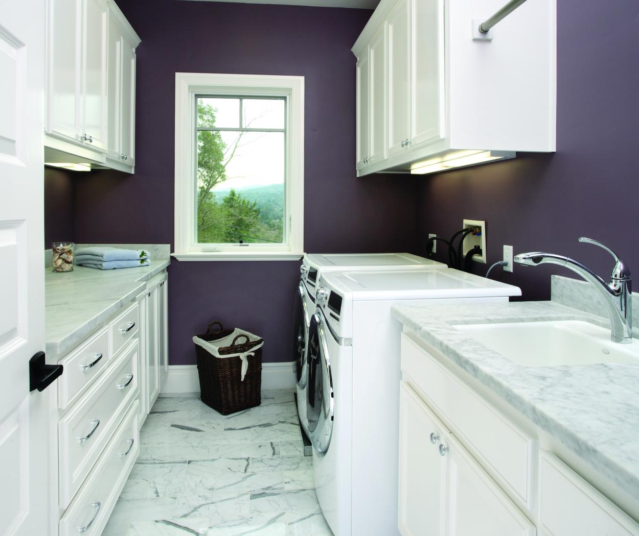 Transitional White Laundry Room with Beautiful Marble Counter Tops and Whirlpool Washer - Dryer