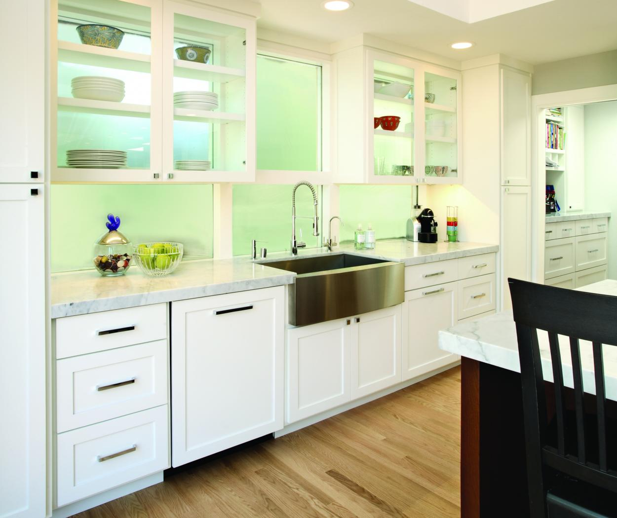 White Transitional Kitchen with Glass Doors, Marble Counter Tops and a Beautiful Farm House Sink