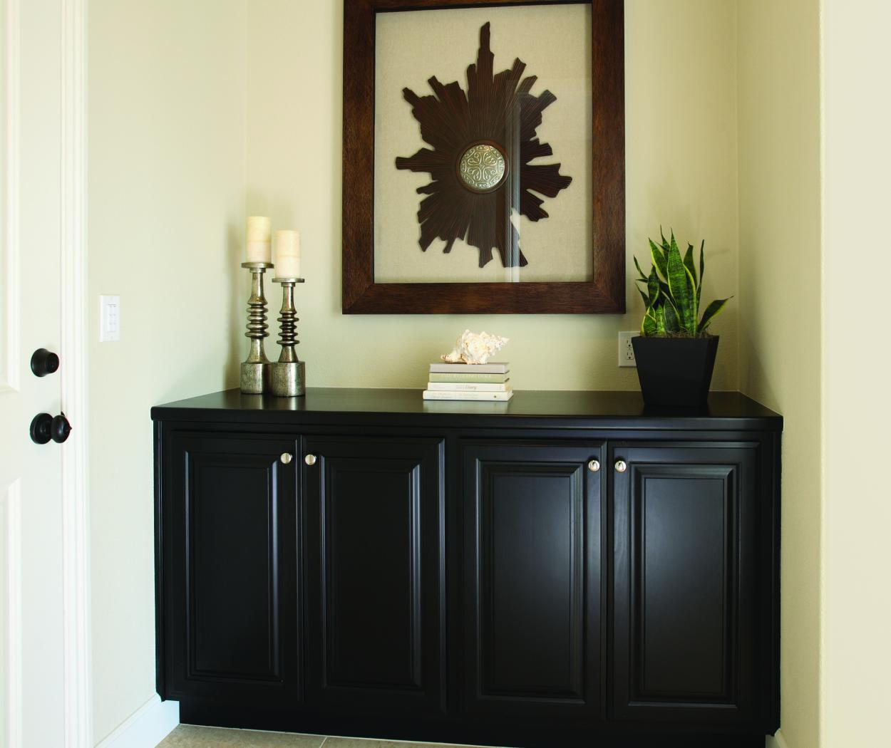 Beautiful Entry Built-In Stained in a Dark Espresso with a Matching Wood Top and Chrome Knobs
