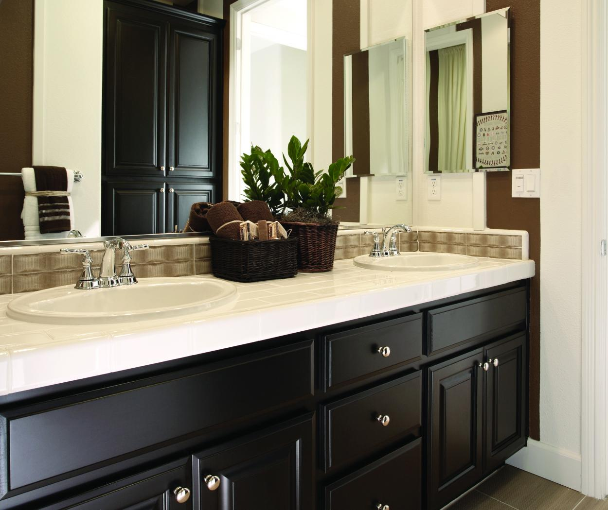 Traditional Bathroom Vanity Stained in Dark Espresso with Double Sinks, an Off White Counter Top and Amerock Knobs