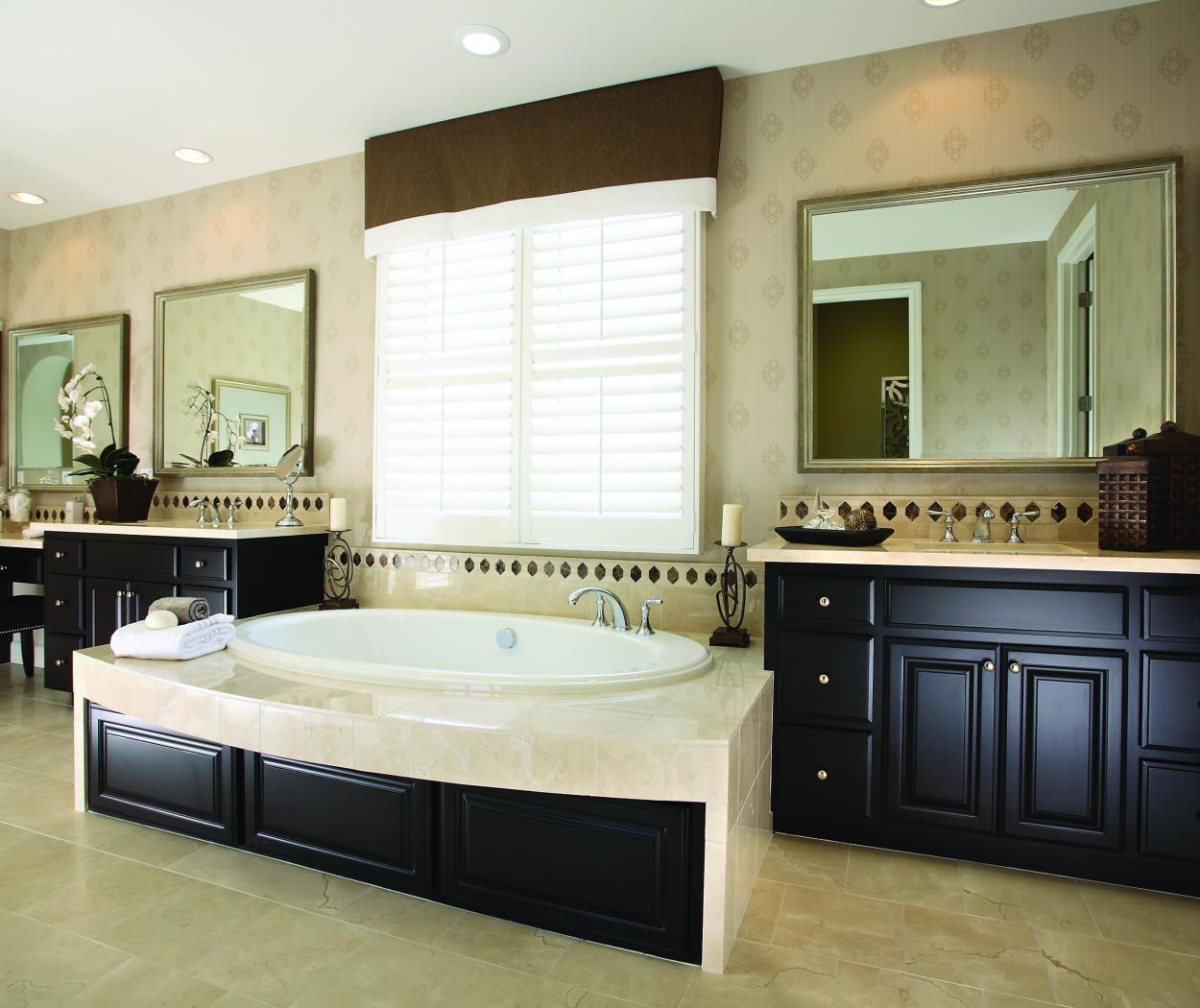 Traditional Master Bathroom with Double Vanities Stained in Dark Espresso with Marble Counter Tops and Amerock Knobs