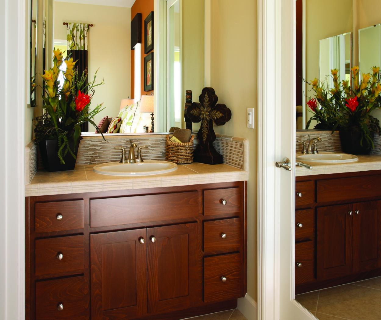 Beautiful Stained, Shaker Style Bathroom Vanity with a Chrome Faucet and Knobs