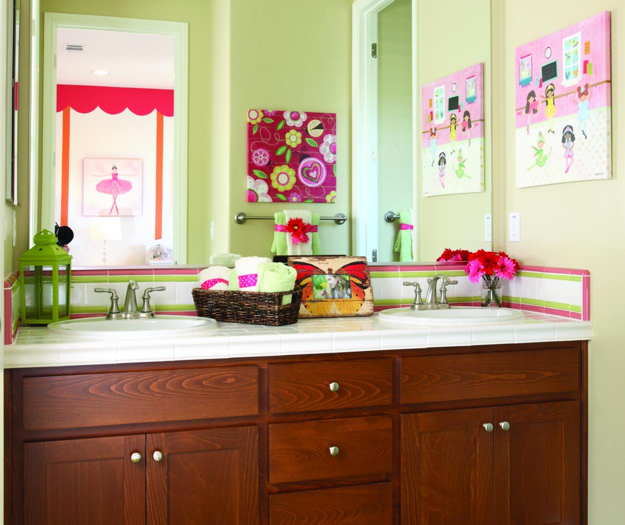 Little Girls Stained Bathroom Vanity with Chrome Hardware and a White Counter Top