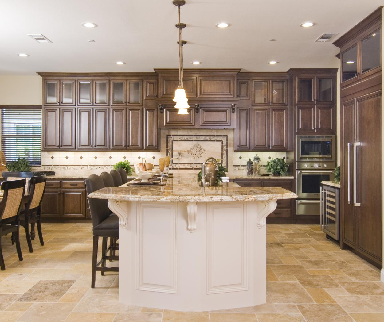 Traditional Stained Kitchen with a Beautiful Off White Island, Glass Doors, Granite Counter Tops and Oil Rubbed Bronze Hardware