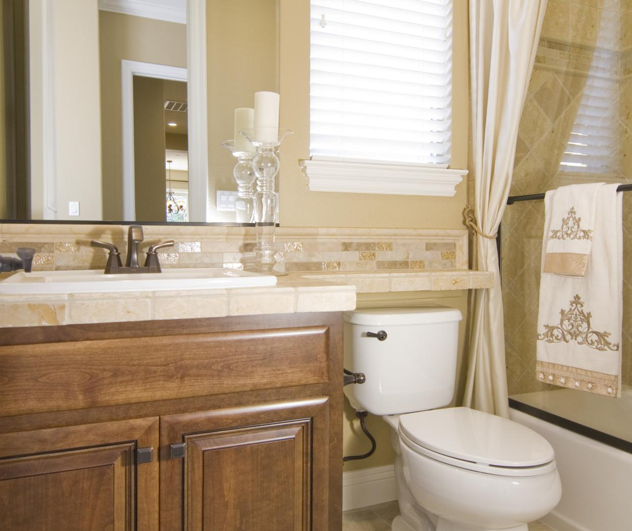 Traditional Stained Bathroom Vanity with a Tile Countertop and Oil Rubbed Bronze Knobs