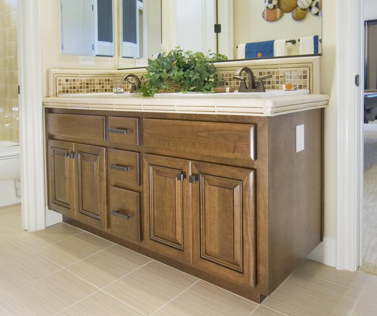 Traditional Stained Bathroom Vanity with a Tile Countertop and Oil Rubbed Bronze Hardware