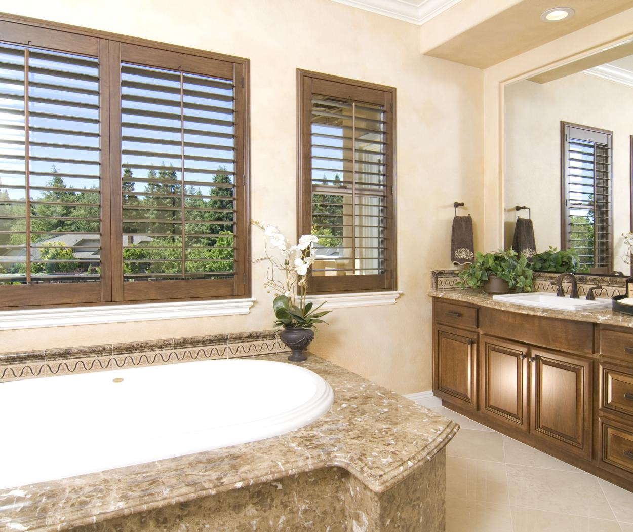 Traditional Stained Master Bathroom with Double Vanities, Beautiful Granite Counter Tops and Oil Rubbed Bronze Hardware