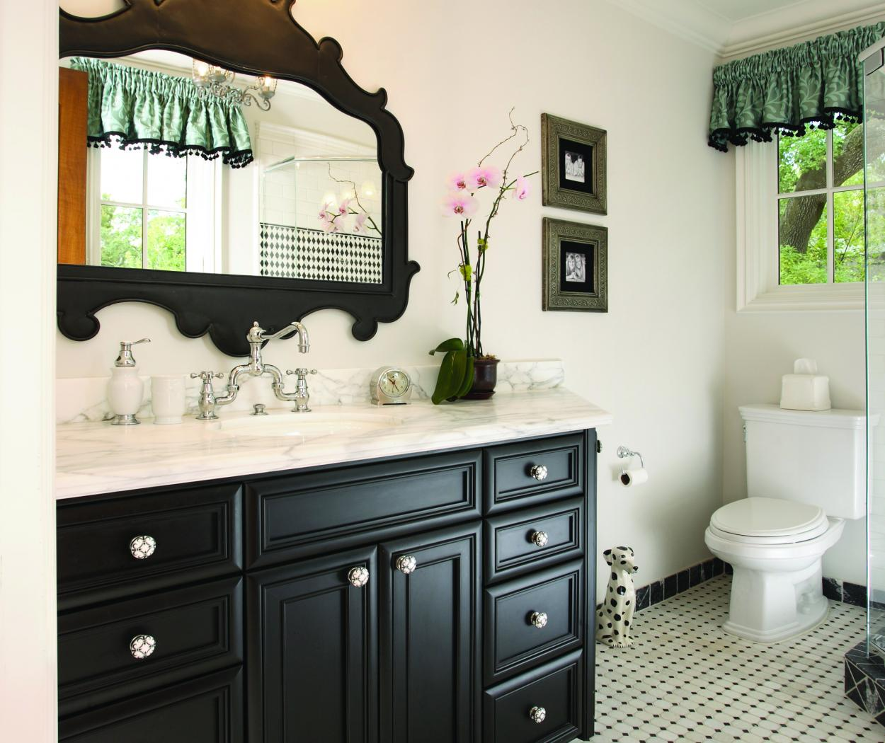 Transitional Bathroom Vanity Stained in Dark Espresso with a Beautiful Marble Counter Top and Decorative Knobs