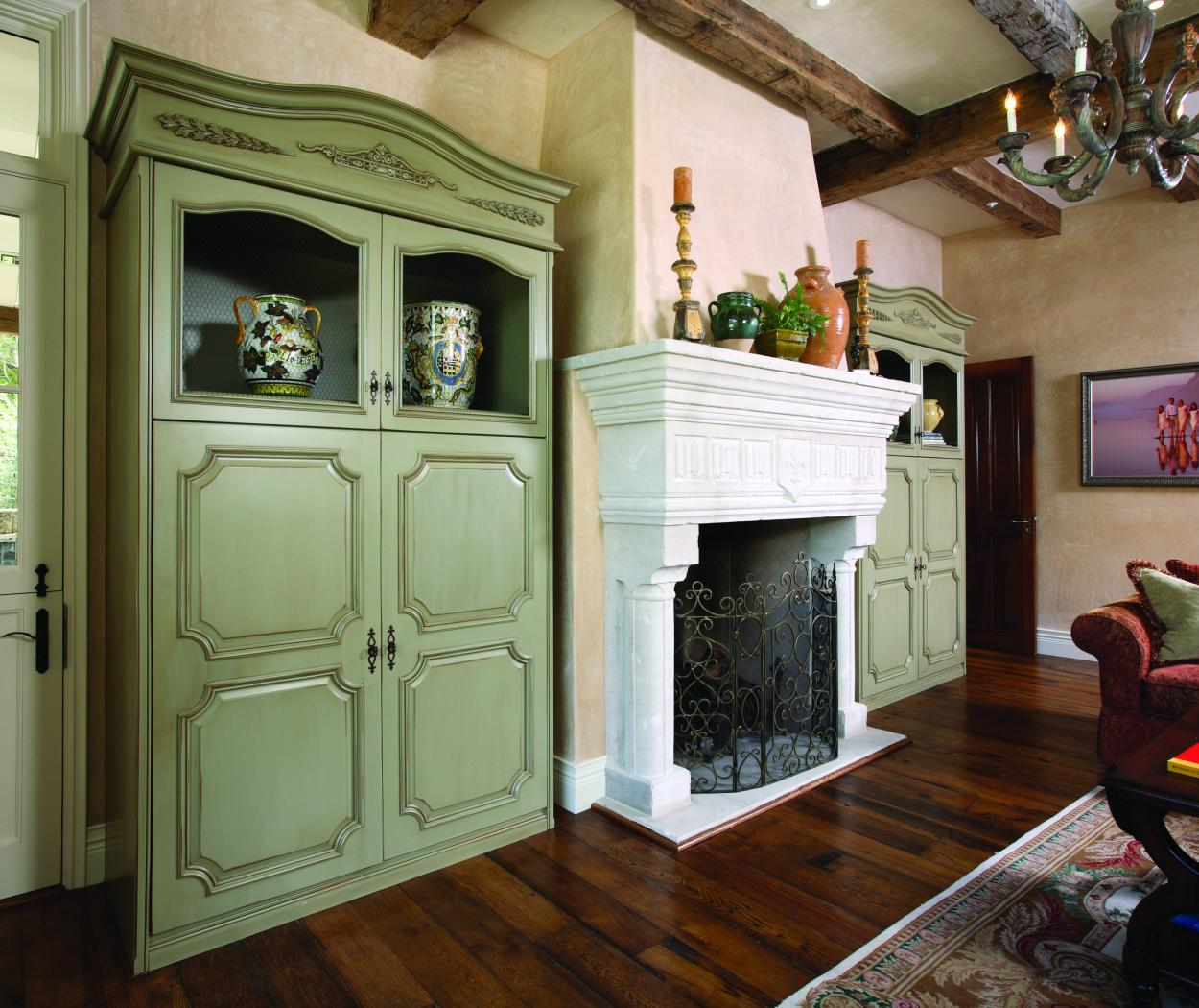 Two Antique Light Green Family Room Built-Ins with Glass Doors and Decorative Molding