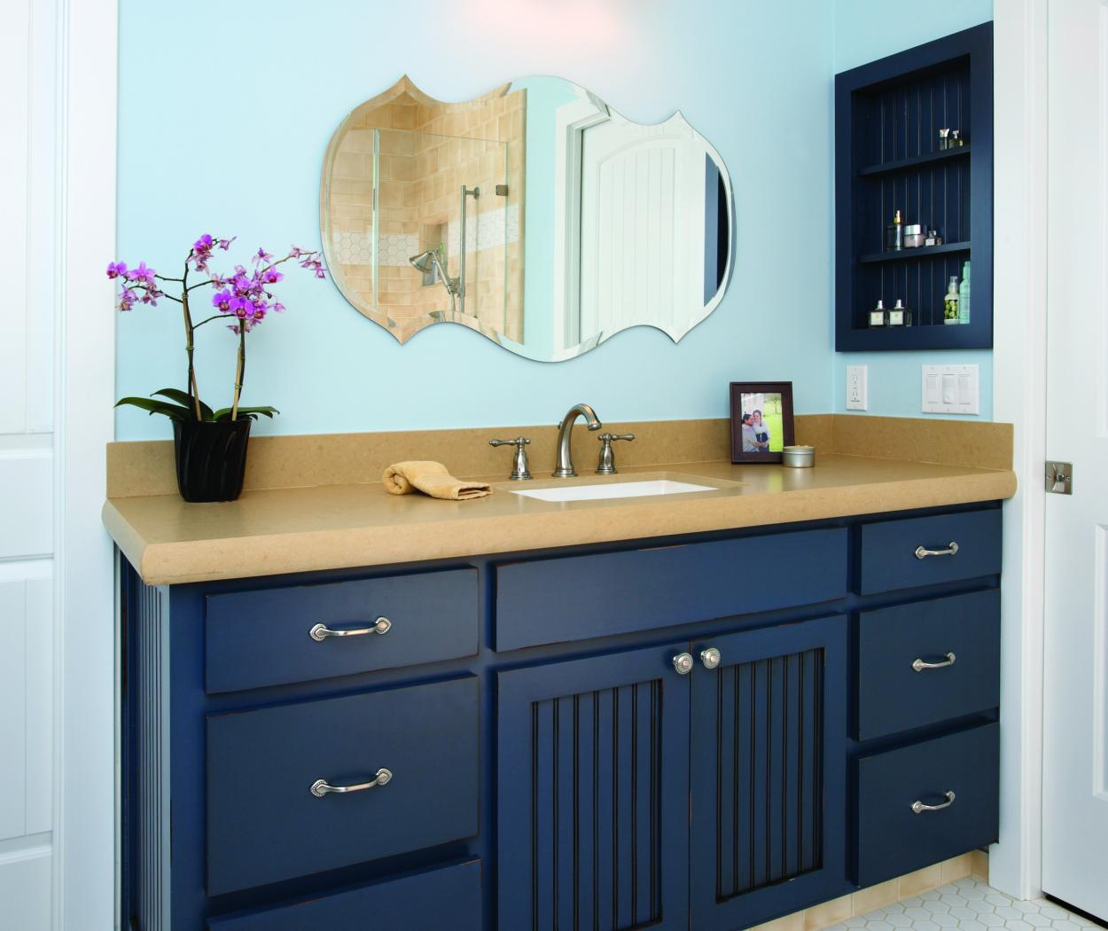 Beautiful Navy Bathroom Vanity with Beadboard Doors, Open Shelves and Decorative Hardware