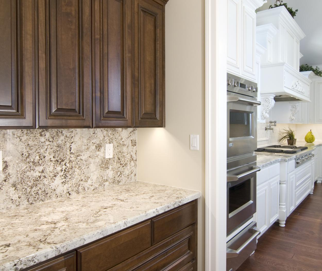 Traditional Chocolate Stained Butler's Pantry with a Beautiful Marble Countertop