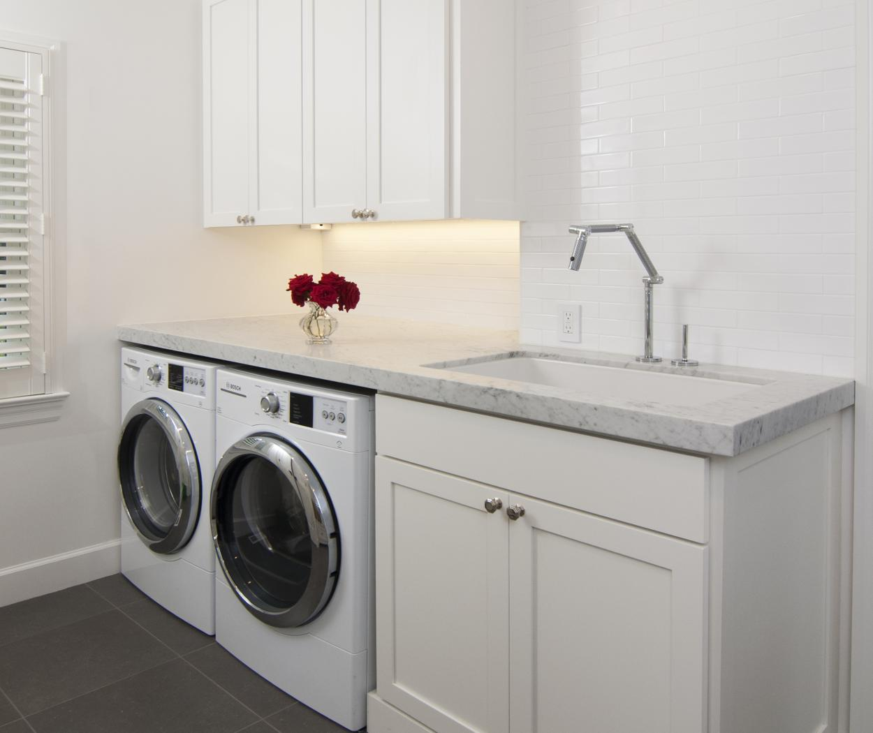 White Transitional, Shaker Style Laundry Room with a Beautiful White Marble Countertop and Bosch Washer - Dryer