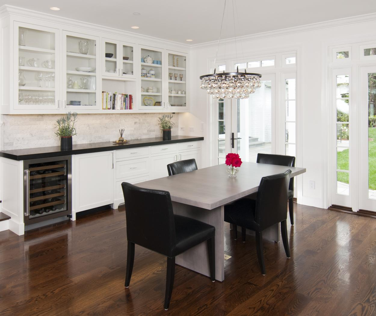 Transitional White, Shaker Style Wine Bar with a Black Countertop, Built-In Wine Cellar and Beautiful Glass Doors