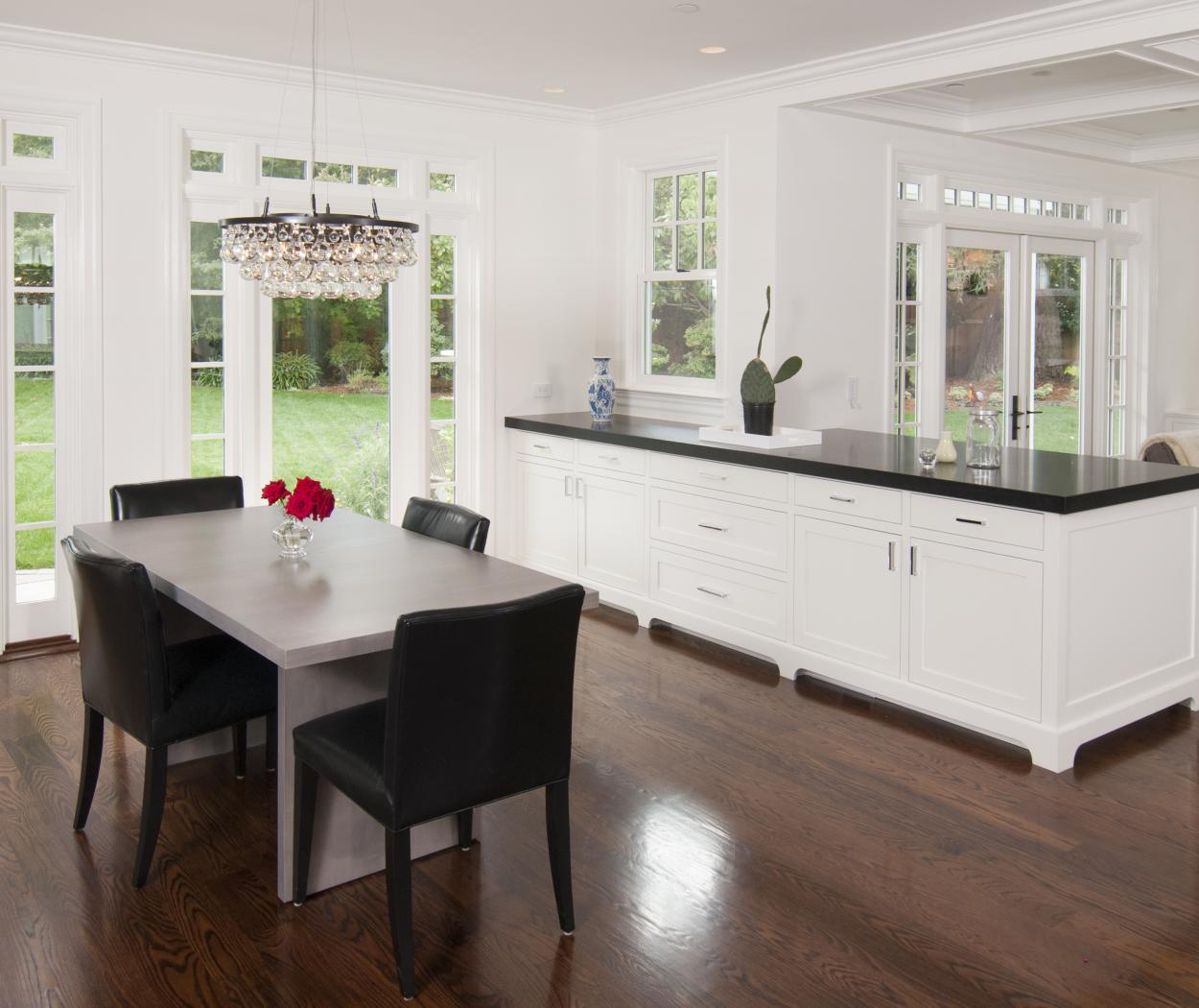 White Transitional, Shaker Style Dining Room Built-In with a Black Countertop and Chrome Hardware