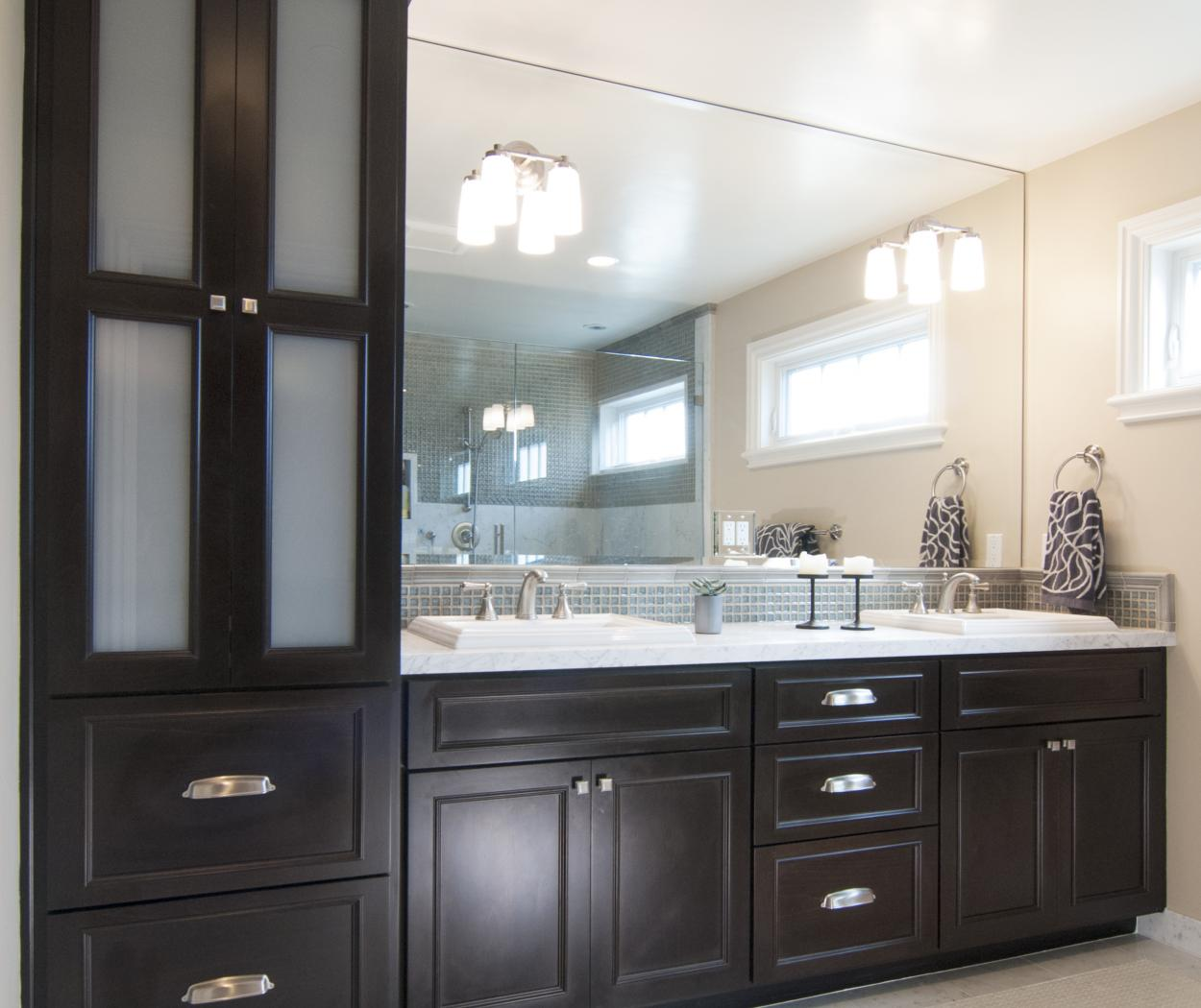 Transitional Dark Espresso Stained Master Bathroom Vanity with Double Sinks, Silver Hardware and a White Marble Counter Top
