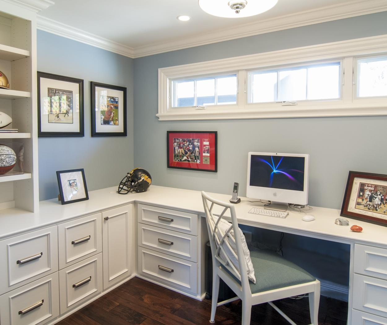 Beautiful White Office Built-Ins with Open Shelves and Silver Hardware