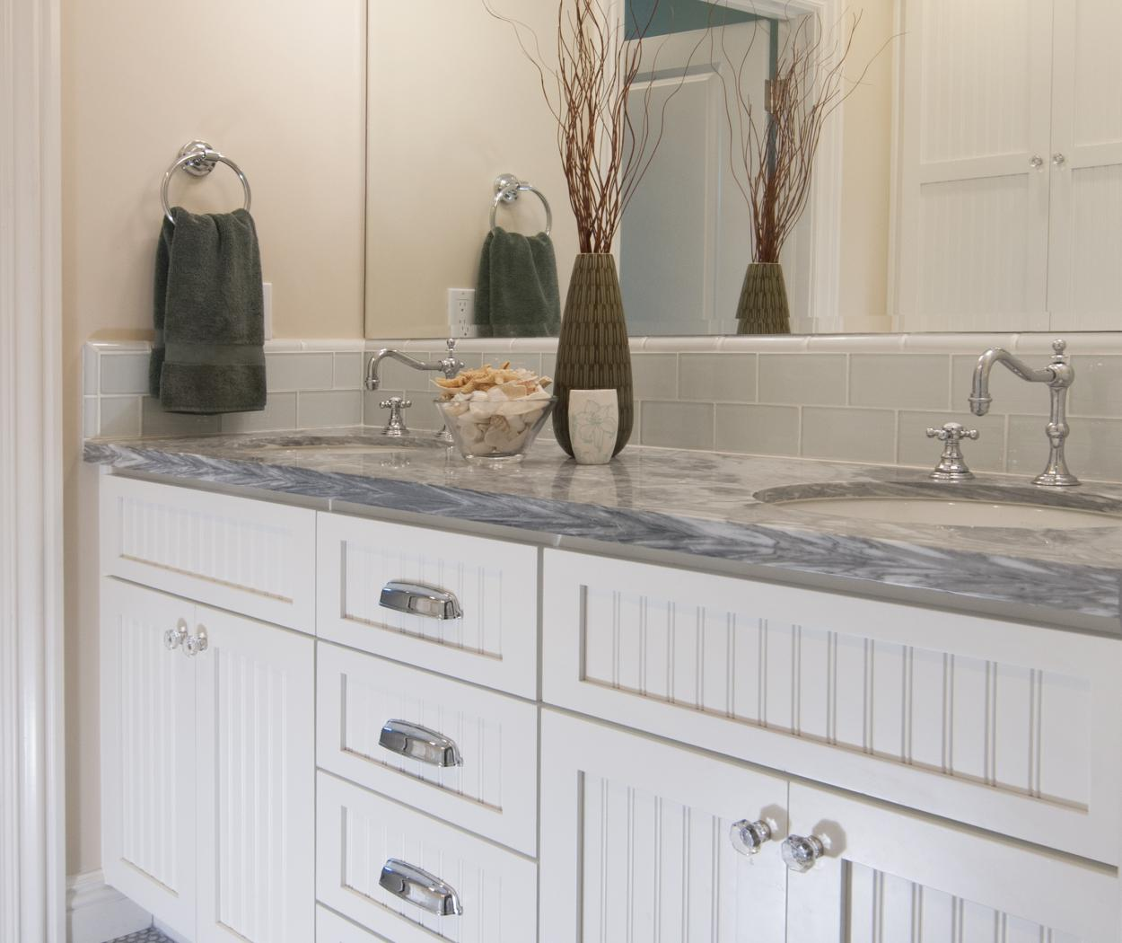 Transitional White Bathroom Vanity with Beadboard Doors, Silver Hardware, Marble Counter Top and Double Sinks