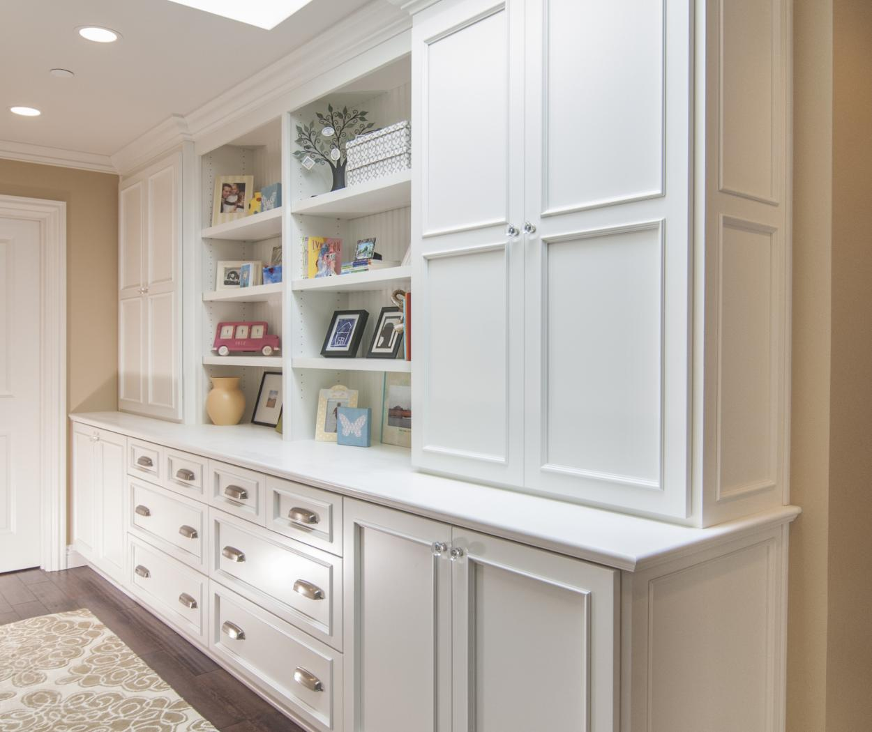 Beautiful White Transitional Built-In with Beardboard Backing, Open Shelves and Diamond Shaped Knobs