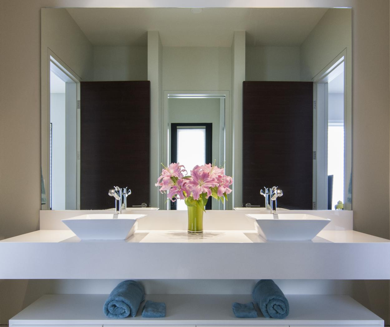 Beautiful White Contemporary Master Bathroom Floating Vanity with Double Sinks and a White Counter Top