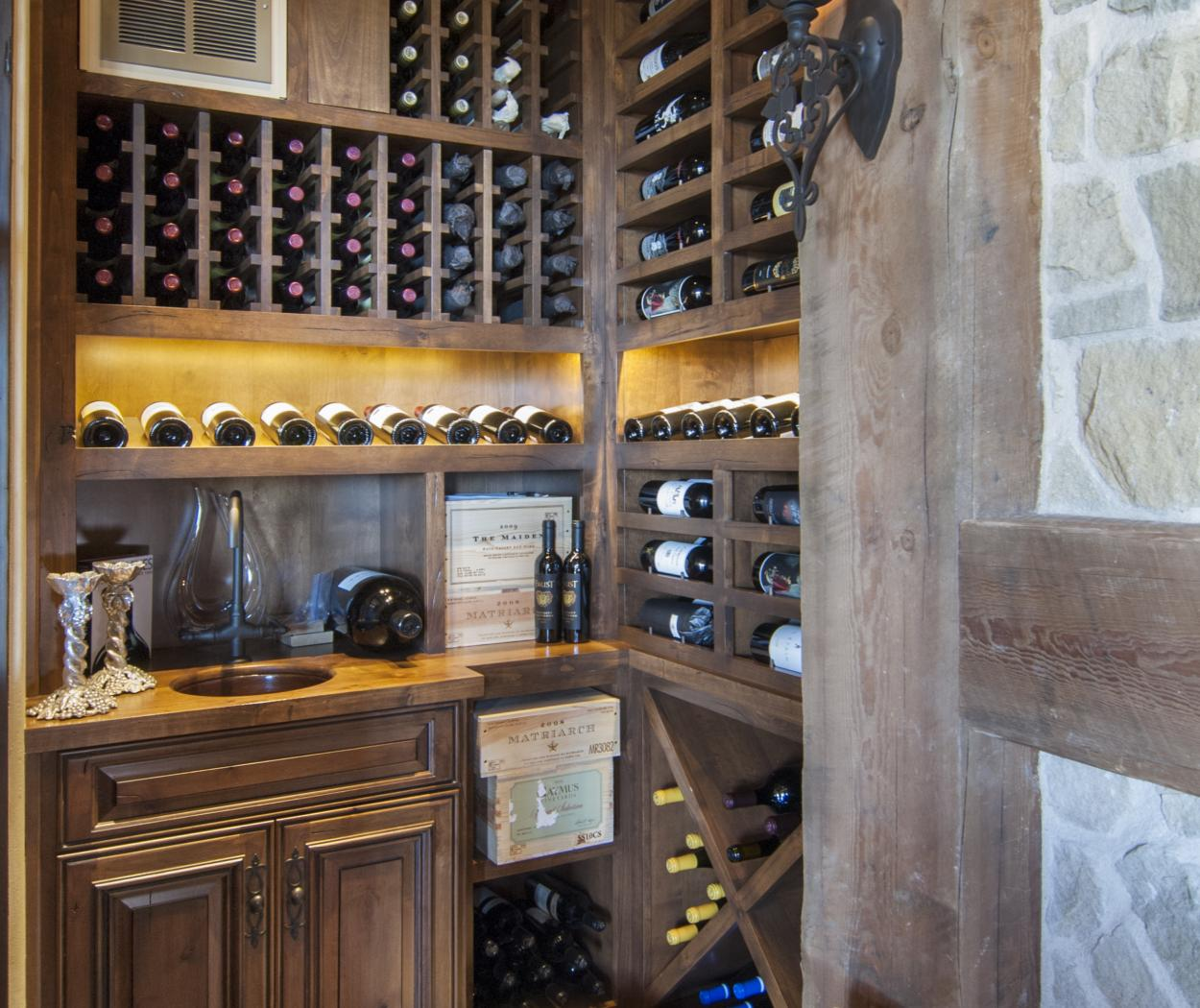 Beautiful Rustic Wine Room with Vertical Wine Storage and Built in Wine Cellar