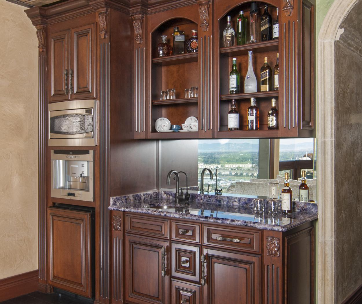 Beautiful Bar Built-In for a Pool House with Open Shelves, Granite Counter Top and Stainless Steel Appliances