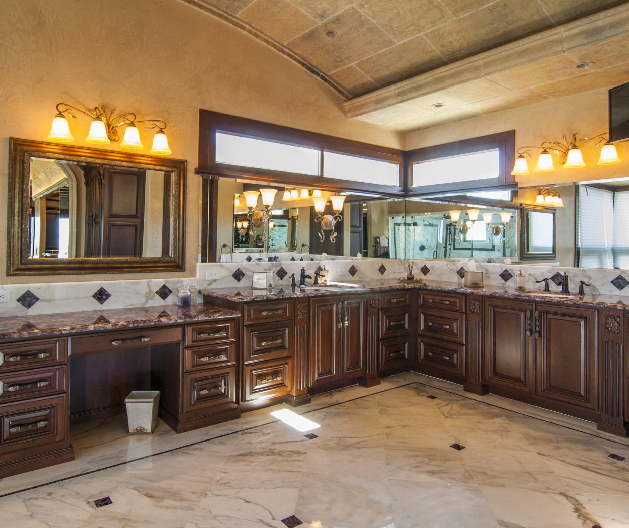 Traditional Master Bathroom Vanity with Double Sinks, Oil Rubbed Bronze Faucets and Beautiful Granite Counter Tops