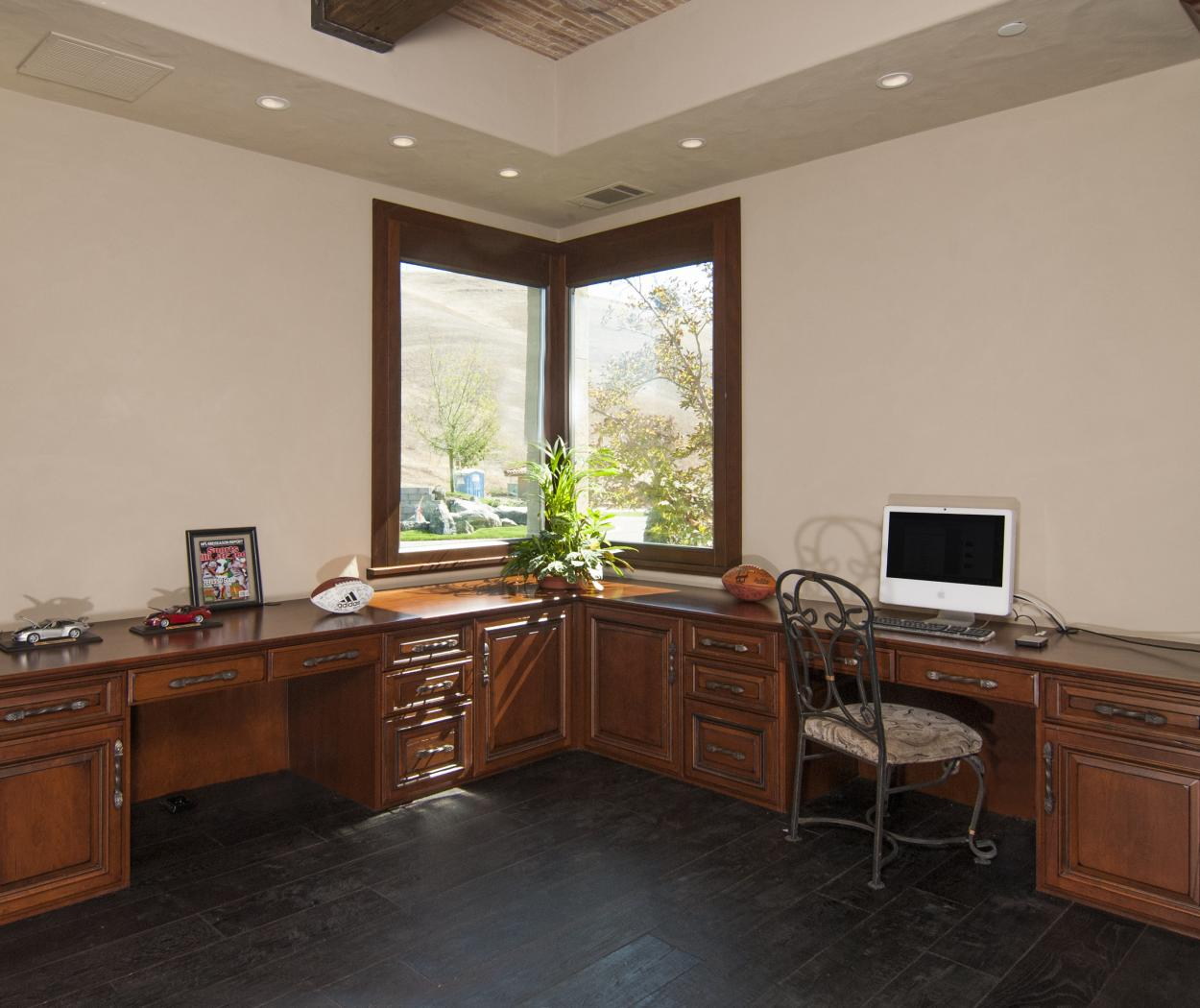 Traditional Office Built-In Desk with Wood Tops and Decorative Hardware