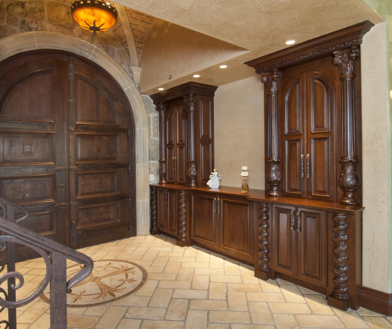 Traditional Entry Built in with Ornate Decorative Posts and a Wood Counter Top