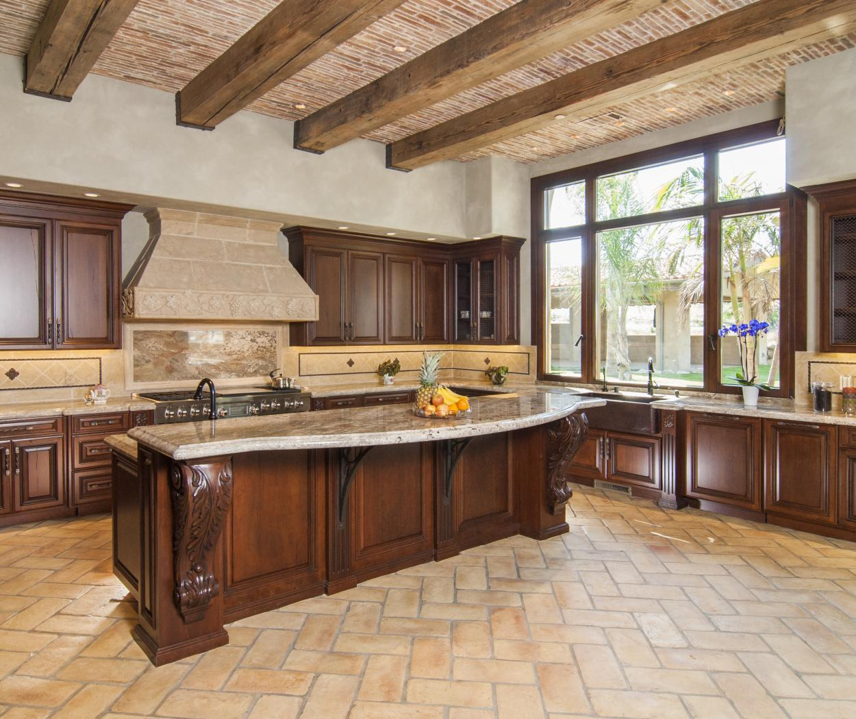Traditional Kitchen with a Beautiful Cast Stone Hood, Decorative Corbels, Wire Mesh Doors and Stainless Steel Appliances