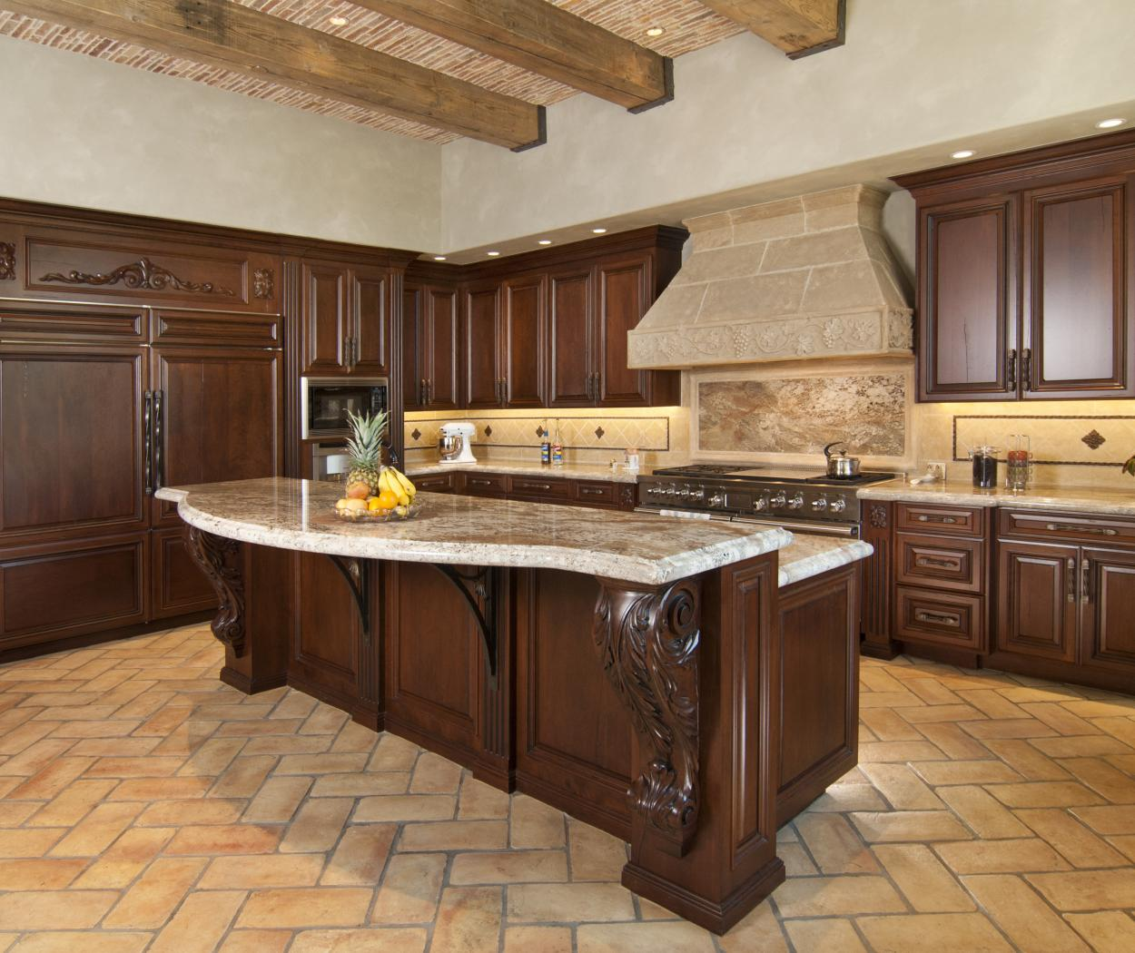 Traditional Kitchen with a Beautiful Cast Stone Hood, Decorative Corbels and Stainless Steel Appliances