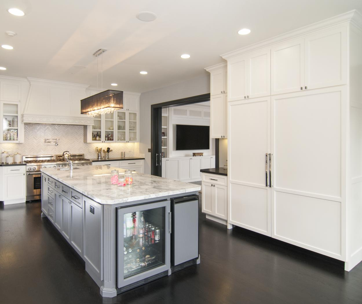 Transitional White Kitchen with a Beautiful Grey Island, Marble Counter Tops, Glass Doors and U-Line Appliances