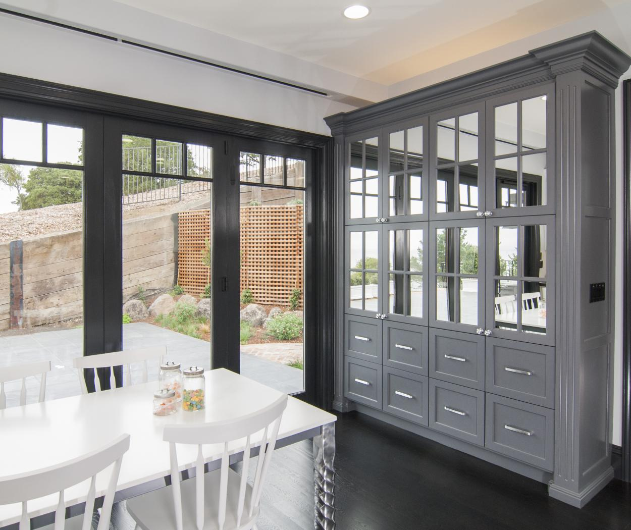 Transitional Light Grey Kitchen Built-In with Beautiful Glass Doors and Silver Pulls