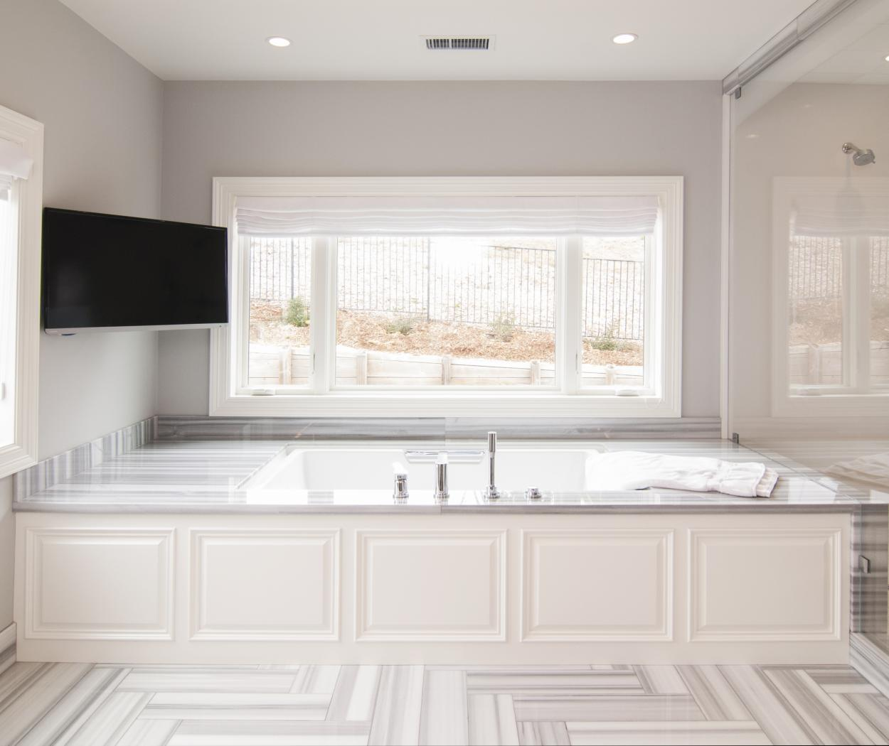 White Traditional Master Bathroom Built-Ins with a Beautiful White and Grey Marble Counter Top
