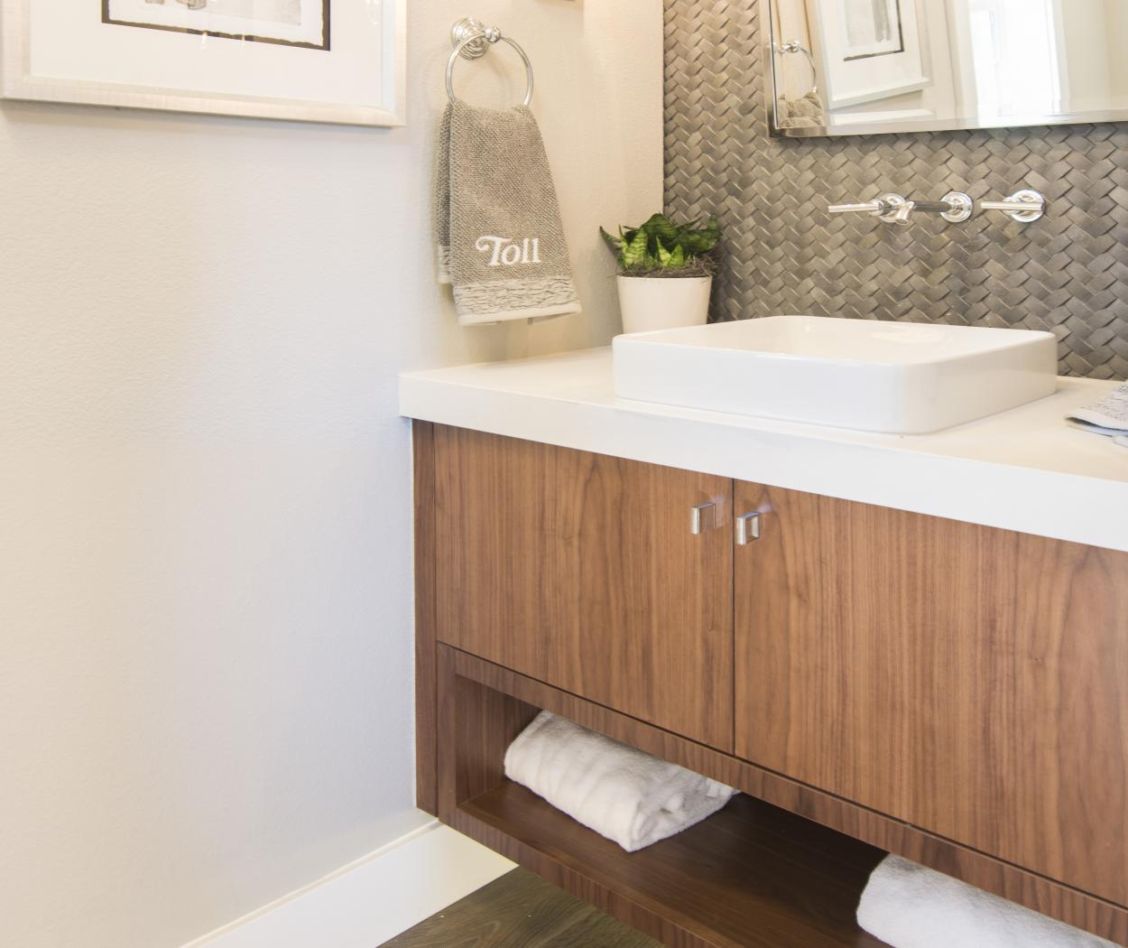 Walnut Contemporary Bathroom Vanity with a White Counter Top and a Built-In Faucet